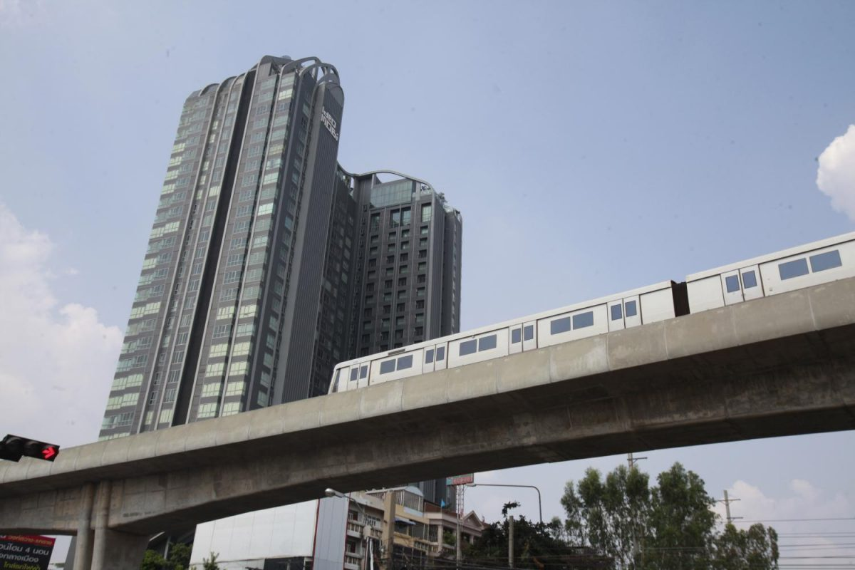 BTS skytrain passing a building